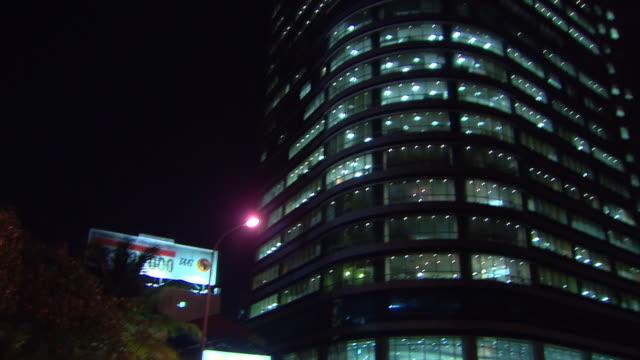 MS POV TU TD Buildings and traffic at night / Luanda, Angola