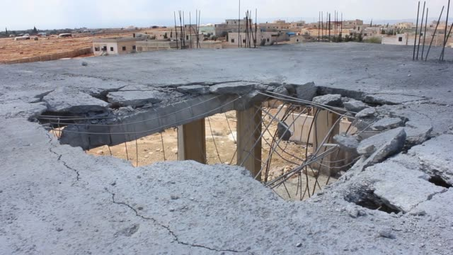Buildings and vehicles belonging to a civil defence center in the opposition controlled Kafr Hamrah village of Aleppo have been destroyed in the...