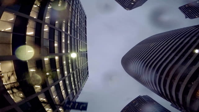 stockvideo's en b-roll-footage met buildings at rainy day - look up at the sky - hoofdletter