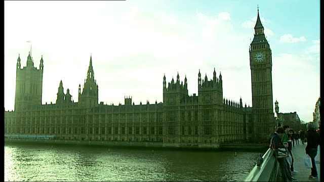 big ben clock tower subsiding into the river thames england london westminster ext big ben clock face showing 245pm gv houses of parliament seen... - victoria tower stock-videos und b-roll-filmmaterial