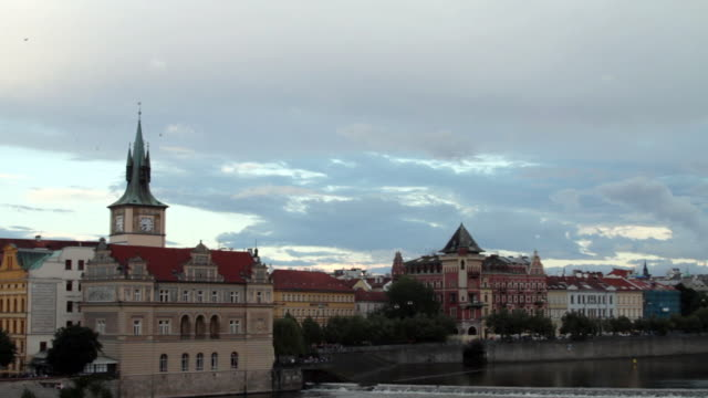 stockvideo's en b-roll-footage met buildings by the charles river in prague. - praag