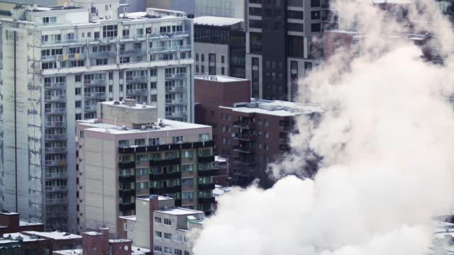 Buildings emit smoke in winter
