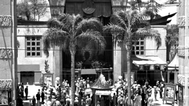 dx - buildings - h.m.l.s. down on the court of the chinese theater - hollywood - a fair crowd on - b&w. - mann theaters stock videos & royalty-free footage