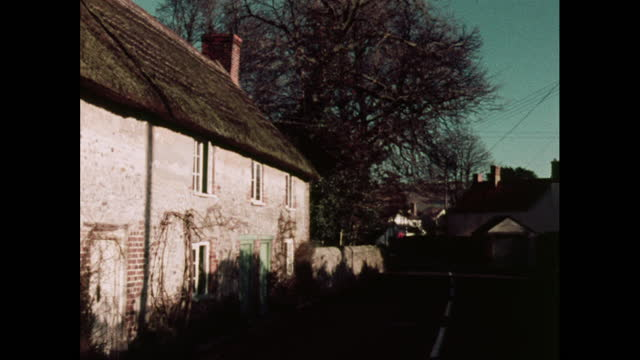 buildings in a quaint village, uk, 1970s - village stock videos & royalty-free footage