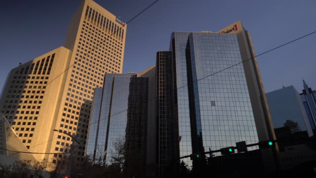 buildings in calgary illuminated by sunrise - alberta stock videos & royalty-free footage