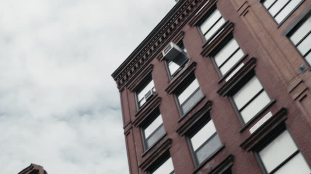 buildings in district of new york city - fire escape stock videos & royalty-free footage