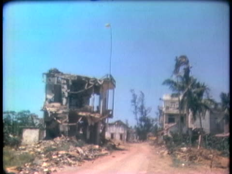 buildings in south vietnam sustain extensive damage in the aftermath of the war. - aerial or drone pov or scenics or nature or cityscape stock videos & royalty-free footage