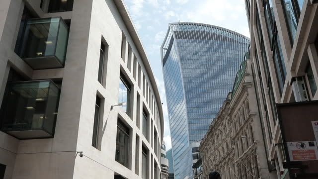 the gherkin cheese grater heron tower newgoldman sachs hq in london uk on monday july 16 2018 - grater utensil stock videos and b-roll footage
