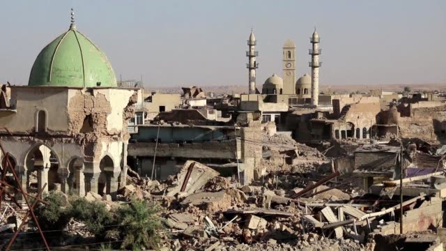 buildings lie in ruins with damage to homes and businesses visible in the streets of iraq's mosul one year after pro government forces recaptured the... - mosul stock videos and b-roll footage