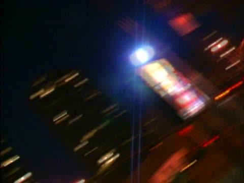 buildings lit up at night - abblenden stock-videos und b-roll-filmmaterial