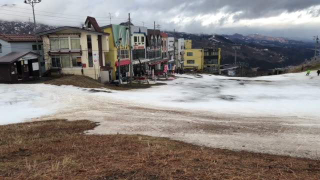 buildings of a ski resort that has had to close a number of slopes because of a lack of snow, on january 30, 2020 in minamiuonuma, japan. large parts... - 30 seconds or greater video stock e b–roll