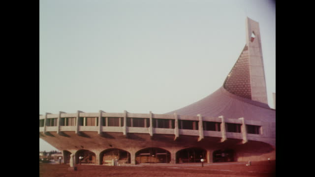 vídeos de stock, filmes e b-roll de 1964, buildings of tokyo, including the yoyogi national gymnasium - 1964
