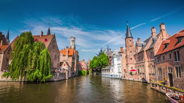 buildings on dijver canal from rozenhoedkaai, bruges, west flanders, belgium - western european culture stock videos & royalty-free footage