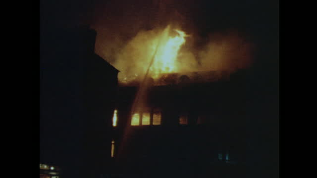 buildings on fire after clashes between protesters and police during the londonderry riots and the battle of the bogside; august 1969. - fire natural phenomenon stock videos & royalty-free footage
