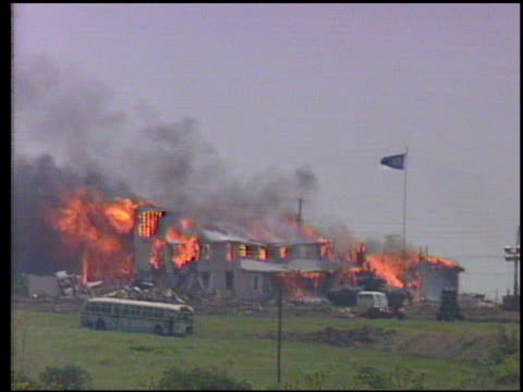 Buildings on fire during FBI siege of Branch Davidian compound people surrender run from fire fire engine arrives Fire Raging on Branch Davidian cult...