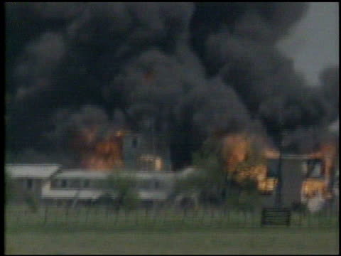 / buildings on fire during the fbi siege on the branch davidian cult compound buidlings on fire during waco siege on april 15 1993 in waco texas - cult stock videos & royalty-free footage