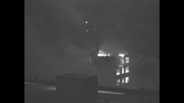 vs buildings on fire in aftermath of flood / note exact day not known - 編集動画点の映像素材/bロール