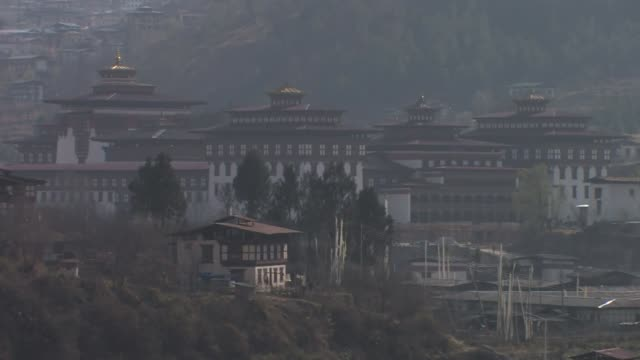 buildings on the hillsides in thimphu, the capital of bhutan. - thimphu stock videos & royalty-free footage