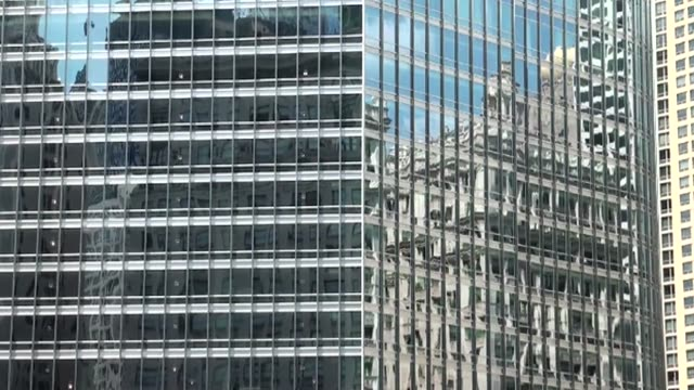 buildings reflected in windows of willis tower high rise - fensterfront stock-videos und b-roll-filmmaterial