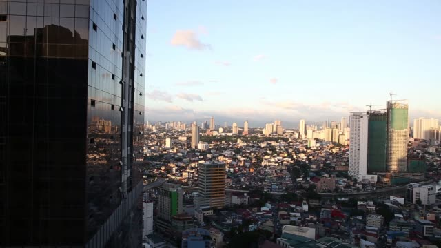 Buildings under constructed near the Pasig River are seen on the skyline at sunset in the Makati district of Manila the Philippines on Friday Nov 20...