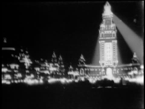 pan buildings with electric lights at american expo / buffalo ny / newsreel - exhibition stock videos & royalty-free footage