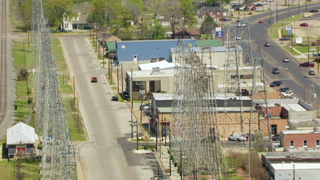 ms aerial buildings with electric towers / kilgore, texas, united states - テキサス州点の映像素材/bロール