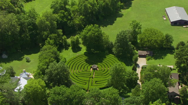 stockvideo's en b-roll-footage met ws aerial pov built structure with labyrinth, forest area in background / posey county, new harmony, indiana, united states - doolhof