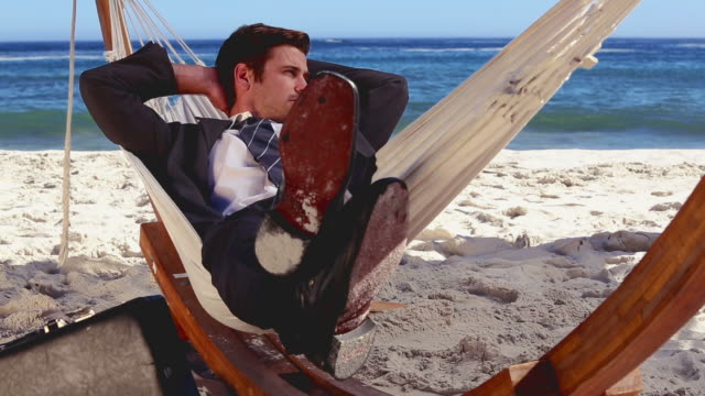 buisnessman relaxing in hammock - legs crossed at ankle stock videos and b-roll footage
