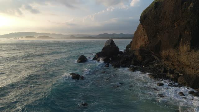 bukit merese drone sunset view - bali stock videos & royalty-free footage