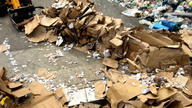 Buldozer Moving Paper on a Dumpsite