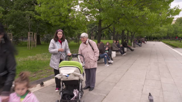 bulgarian square, sofia, bulgaria - legs crossed at ankle stock videos & royalty-free footage