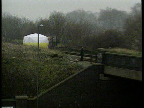 court decision on anonymity LIB Liverpool LS Forensic tent on railway tracks where Bulger's body was found ZOOM IN as men standing next tent MS Men...