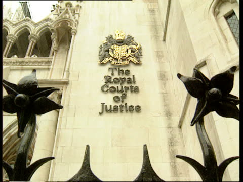high court sentencing ruling high court gloverjames i/c sot la ms sign on wall the royal courts of justice bv people along away to entrance cms side... - domination stock videos & royalty-free footage