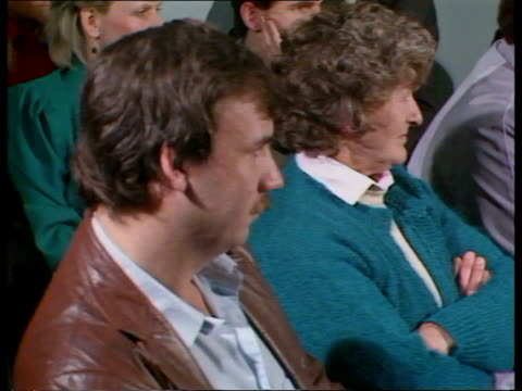 stockvideo's en b-roll-footage met liverpool tgv relatives of seamen from 'mv derbyshire' seated at meeting relatives at meeting cms youth listening to meeting cms elderly couple at... - derbyshire