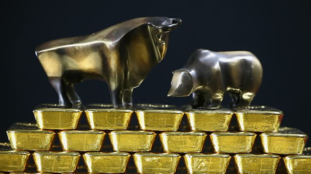 cu bull and bear statues on gold ingots with text on it / hanau, hessen, germany - bear market stock videos and b-roll footage
