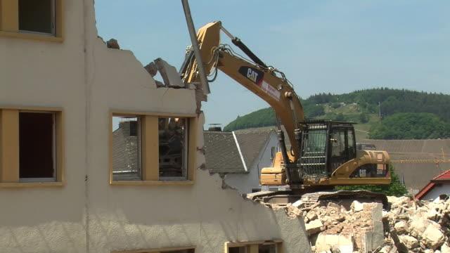 ms bulldozer at demolition of apartment block / saarburg, rhineland-palatinate, germany - bulldozer stock videos and b-roll footage