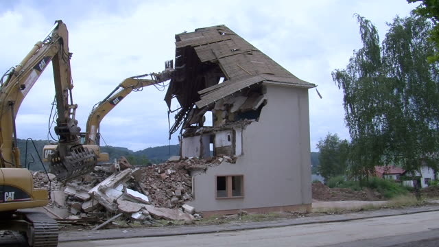 ms bulldozer bring down parts of demolition appartment building / saarburg, rhineland-palatinate, germany - bulldozer stock videos and b-roll footage