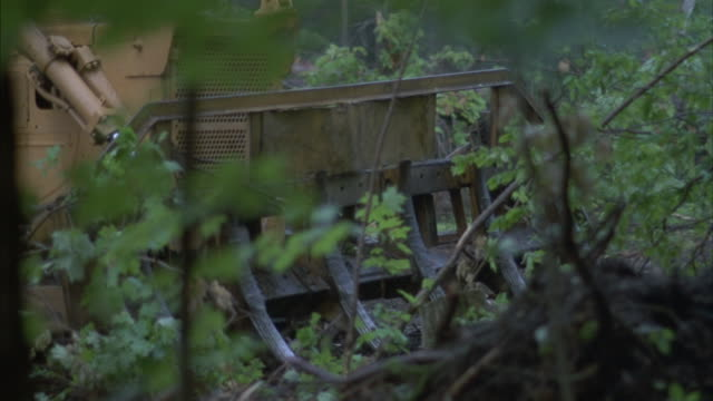 a bulldozer clear a forested area. - bulldozer stock videos and b-roll footage