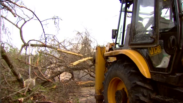 A bulldozer clearing trees felled by Cyclone Fani in Puri India