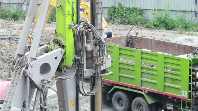 bulldozer construction , truck - pala meccanica video stock e b–roll