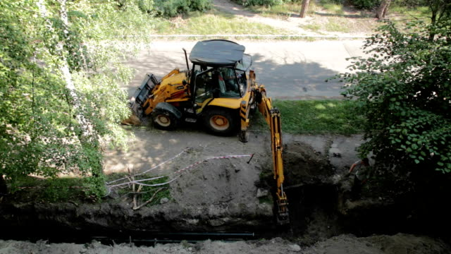 Bulldozer digs a trench.