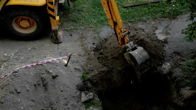 bulldozer digs a trench. - trench stock videos and b-roll footage