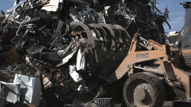 SLO MO, CU Bulldozer grabbing junk scrap metal, Dallas, Texas, USA