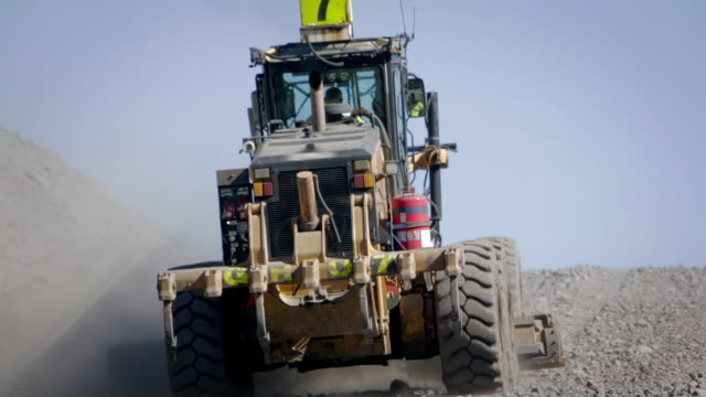 bulldozer grader leveling the ground at a coal mine. - bulldozer stock videos and b-roll footage