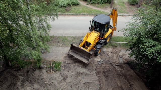 a bulldozer is leveling a piece of land. - bulldozer stock videos & royalty-free footage
