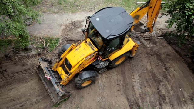 A bulldozer is leveling a piece of land.