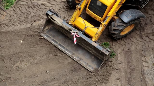 a bulldozer is leveling a piece of land. - vehicle scoop stock videos and b-roll footage