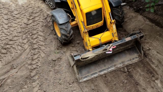a bulldozer is leveling a piece of land. - bulldozer stock videos and b-roll footage