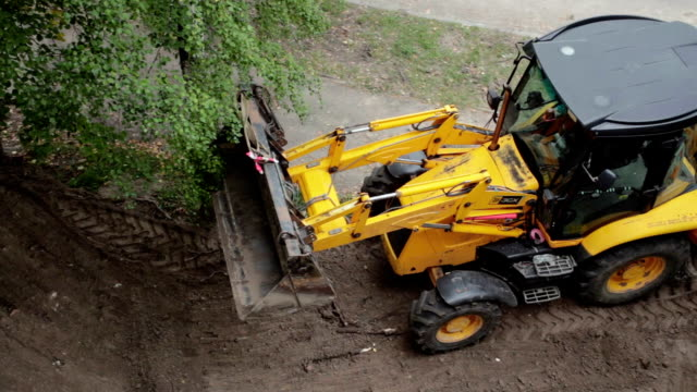 a bulldozer is leveling a piece of land. - construction vehicle stock videos & royalty-free footage