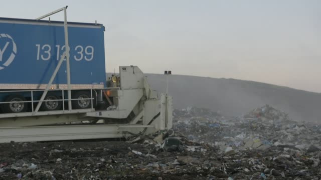 stockvideo's en b-roll-footage met a bulldozer moves garbage in a landfill cell at the melbourne regional landfill site operated by at cleanaway waste management ltd in ravenhall... - afvalverwerking